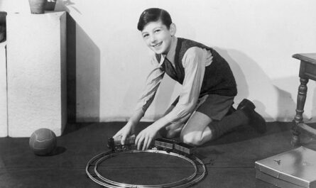 Vintage boy with train set
