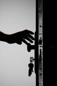Hand on keys opening door